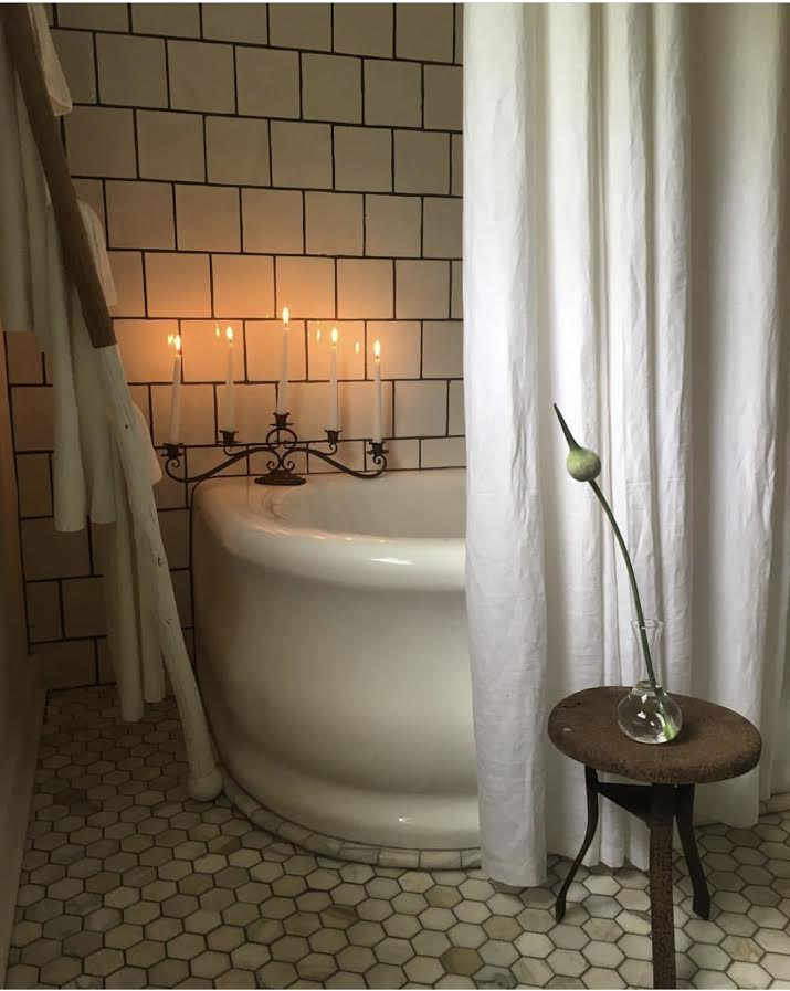 """img src=""""relaxing guest bathroom tub and candles at old suthern soul farm"""""""