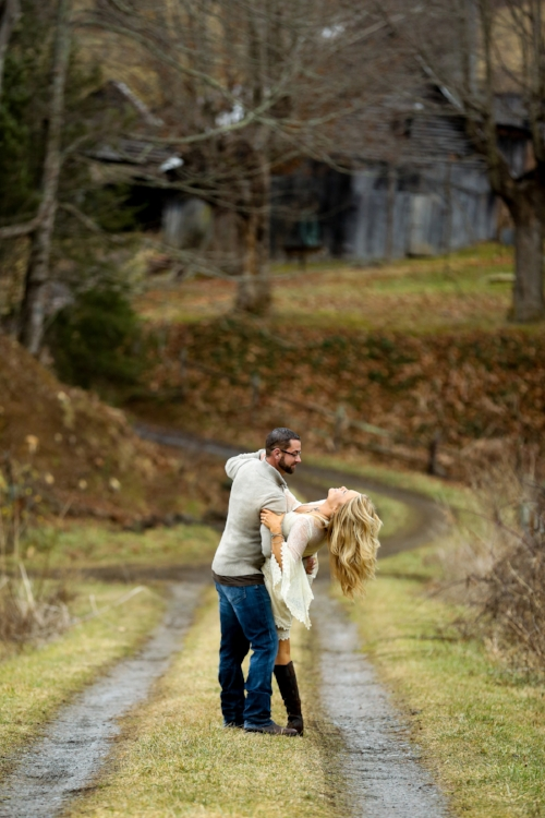 """img src=""""windy driveway couple playing laughing fall weather trees and leaves at old suthern soul farm"""""""
