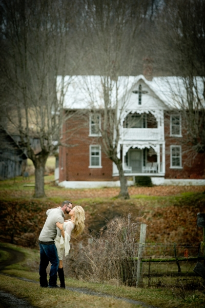 """img src=""""windy driveway old house couple kissing fall weather trees and leaves at old suthern soul farm"""""""