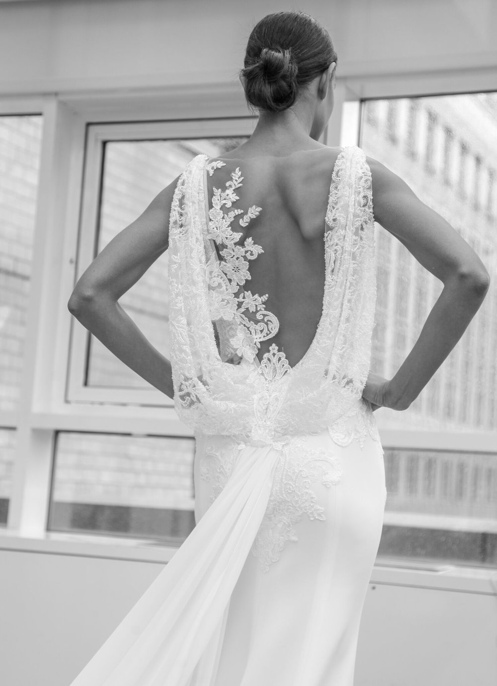 Ines Di Santo creates a lace detailed cowl backline. Balancing a sexy and sophisticated wedding dress look.