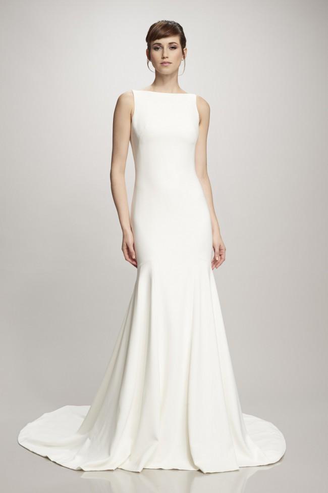 Bauteu neckline with crepe material wedding dress by theia Orlando, FL