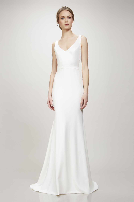 V-neck wedding dress sleek by Theia Couture Orlando, FL