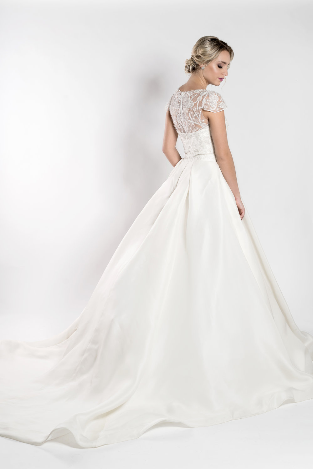 Ballgown wedding dress with detailed back Orlando bridal boutique The Bridal Finery