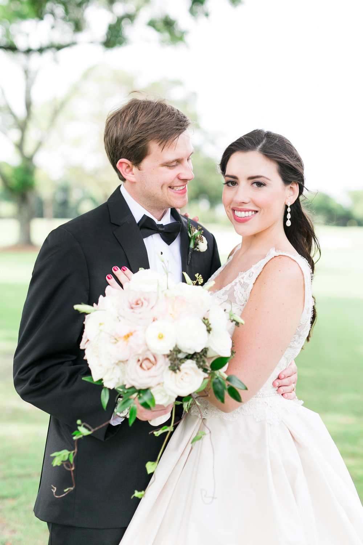 v-neck lace wedding dress in blush.