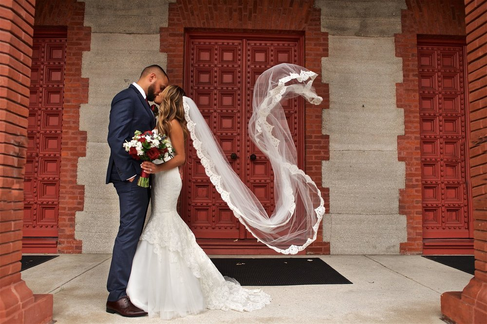 Real bride wearing Monique Lhuillier wedding gown from Orlando