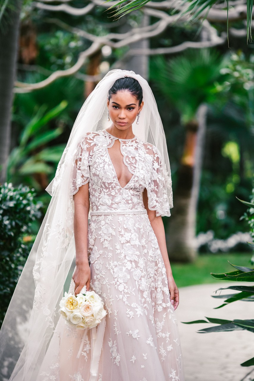 Chanel Iman wearing Zuhair Murad textured wedding dress with floral bouquet
