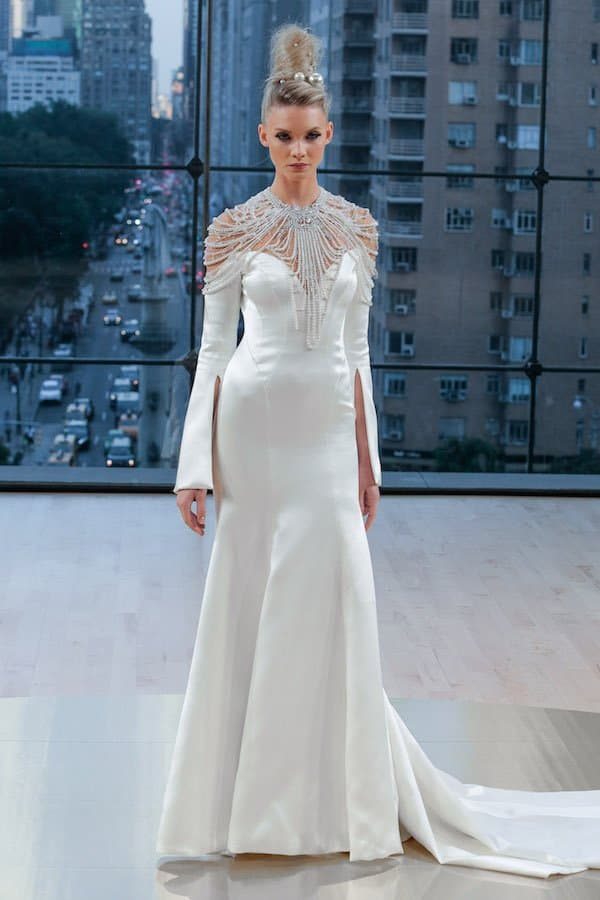 Clean wedding dress with off the shoulder detail by Ines Di Santo available in Orlando