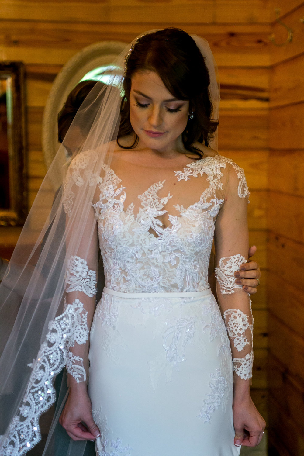 Wendy chose the 'Drenoa' gown by Pronovias. Keeping her bridal look romantic, she added custom sleeves in alterations and paired it with a lace cathedral veil. How gorgeous is she?