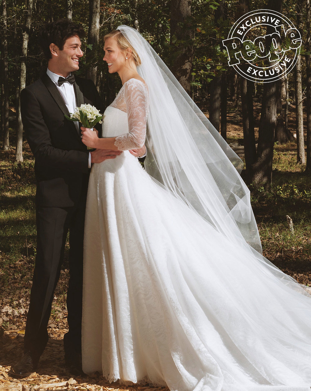 Karlie kloss wore a lace gown wedding gown by dior on her 2018 celebrity wedding