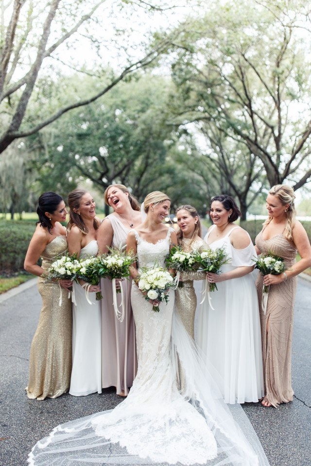 isabel with her bridesmaids. Isabel is wearing a full lace Ines Di Santo wedding dress