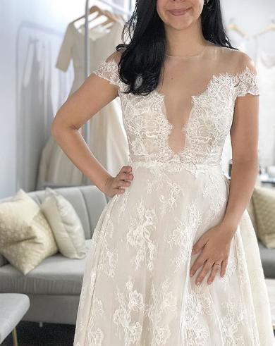A line wedding gown Reem acra wedding dress Orlando reem acra