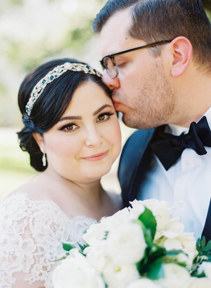 real bride wearing maria elena headpieces blue sapphire crown to her classic wedding in New Orleans