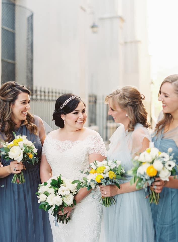 blue bridesmaids dresses and yellow wedding bouquets at southern wedding