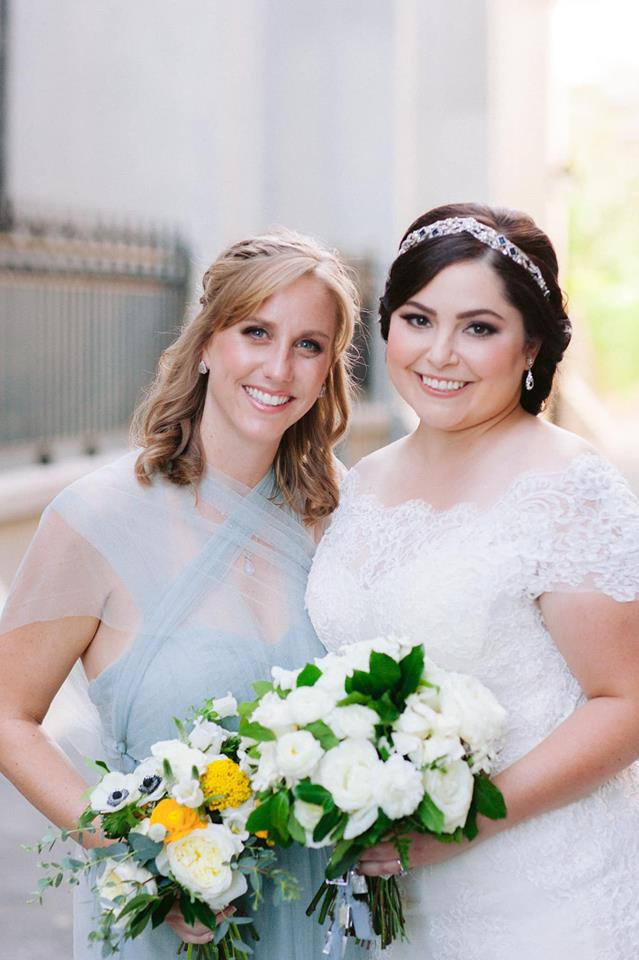 real bride wearing silver tiara by maria elena headpieces on her wedding day with her maid of honor wearing a light blue bridesmaids dress