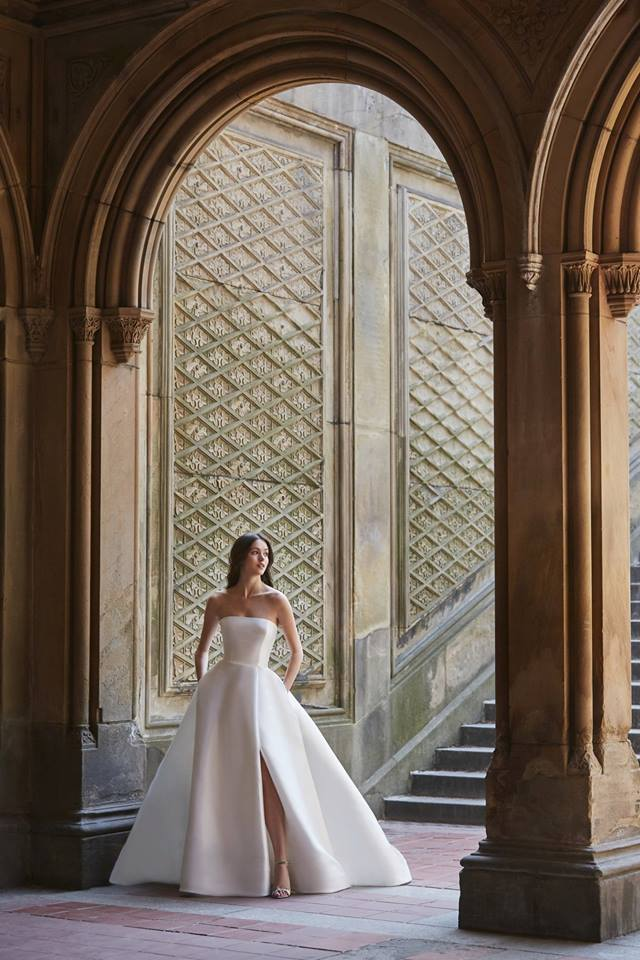 clean strapless ball gown with a slit by monique lhuillier