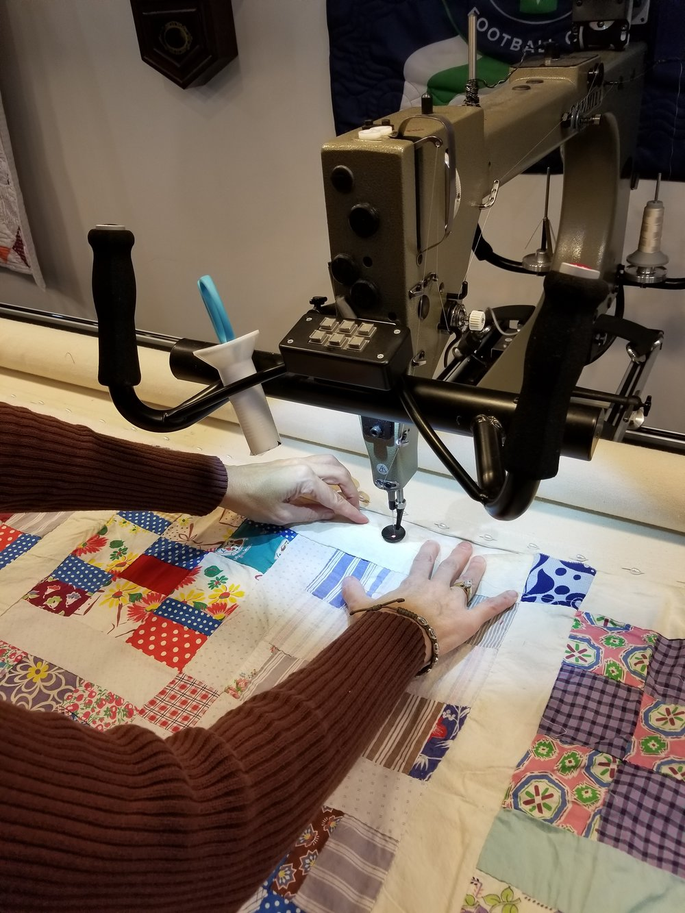 The top being basted so quilting can begin. Notice the variety of fabrics used to make the blocks.