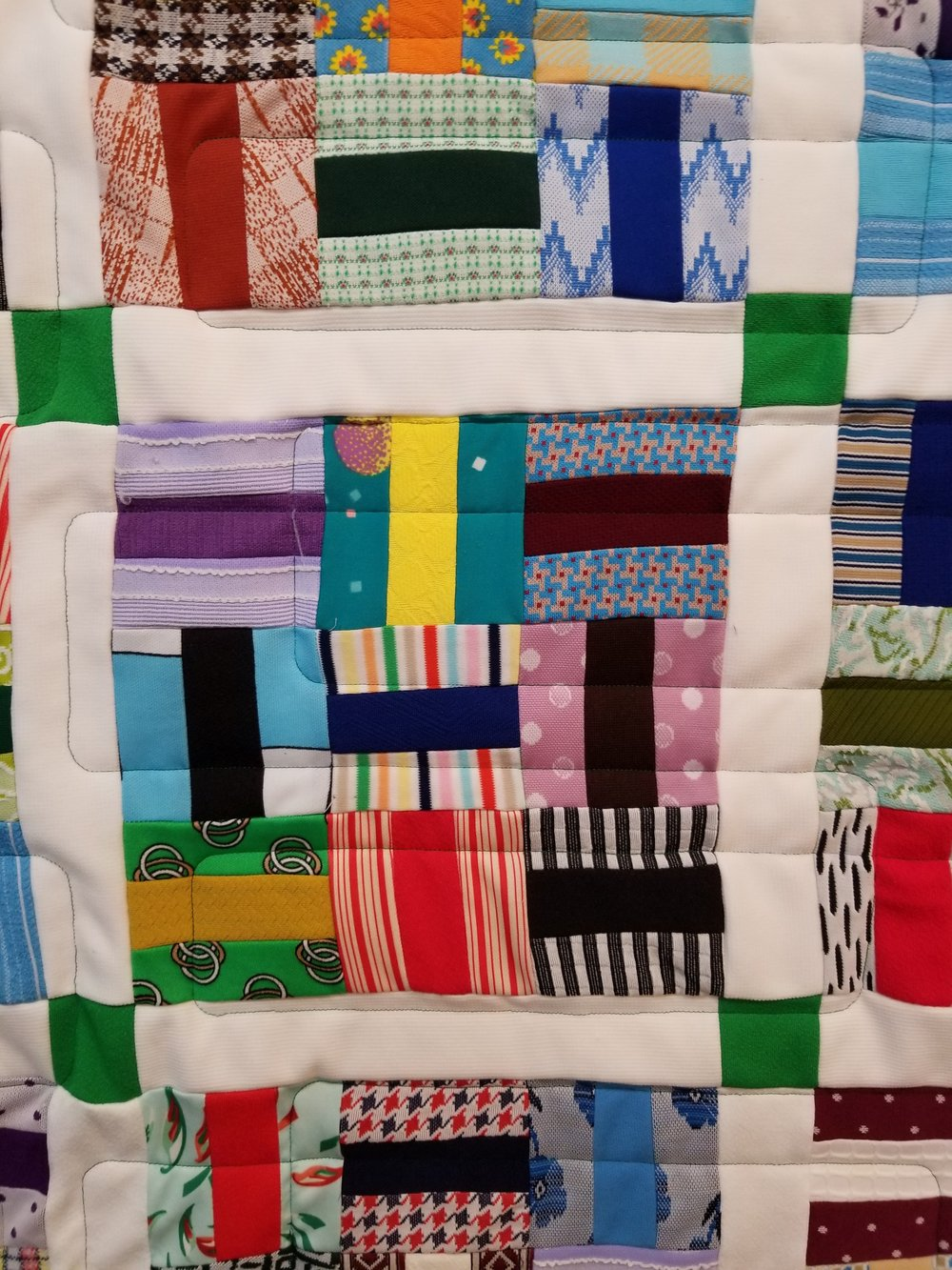 A lot of polyester jumpsuits & leisure suits gave their life for this quilt top!