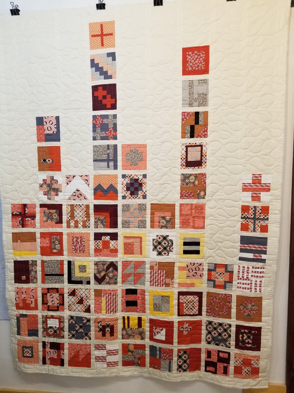 Notice each coloured block is different in this quilt top, no duplicates or repetition.