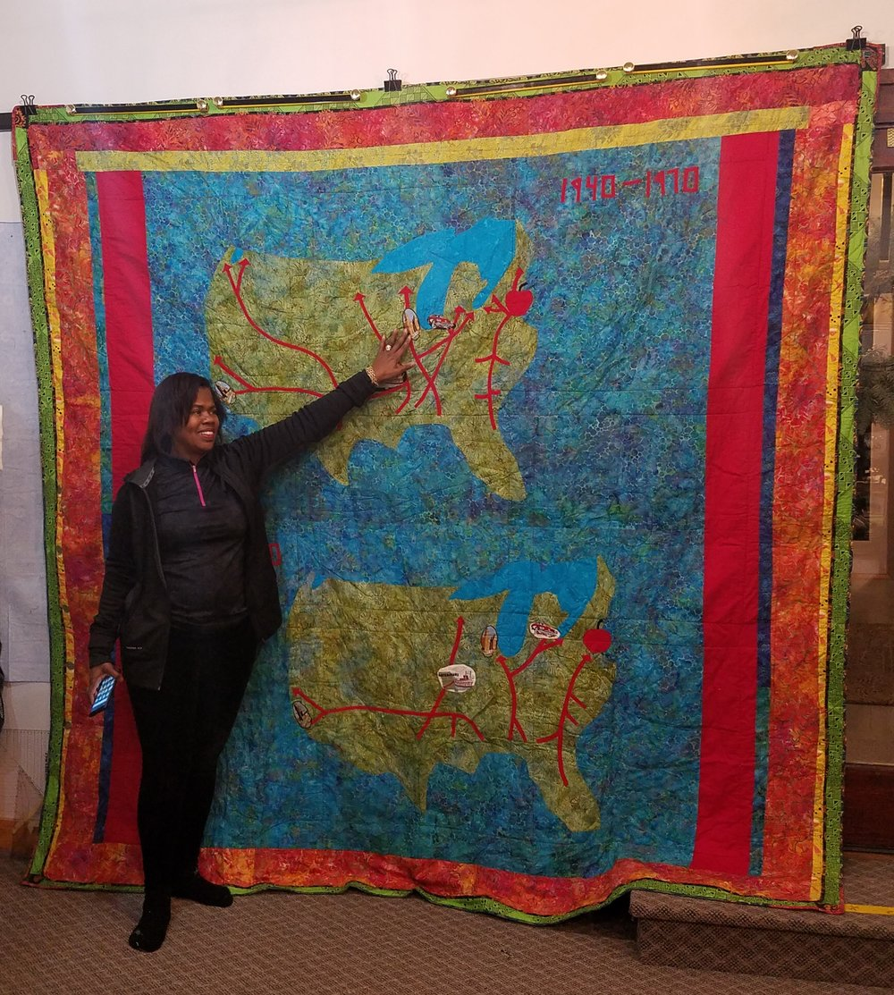 """Here Dorothy is telling us about the back of her """"Freedom to Liberty"""" quilt. I love that she makes both sides a """"front"""", showing another perspective of the migration that took place in two periods of American history."""