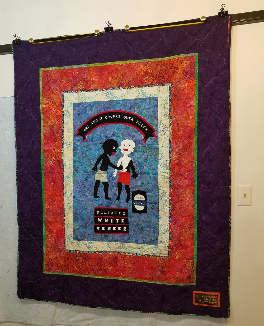 The labels she makes for her quilts are only put on one side of the quilt.
