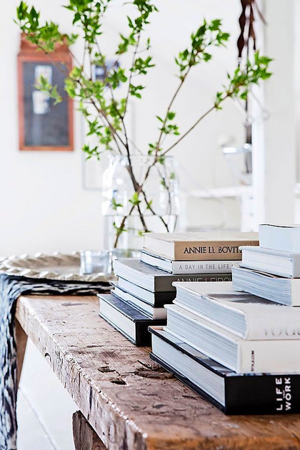 Stack  books and a cut a branch or two from the garden. -
