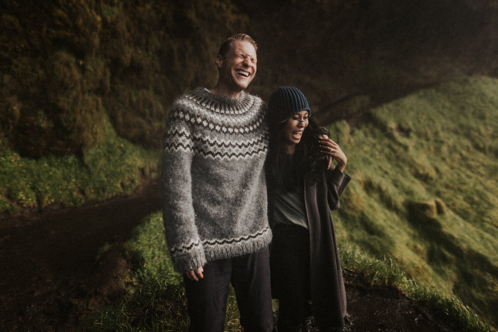 Adorable couples engagment session in Iceland behind a waterfall.jpg