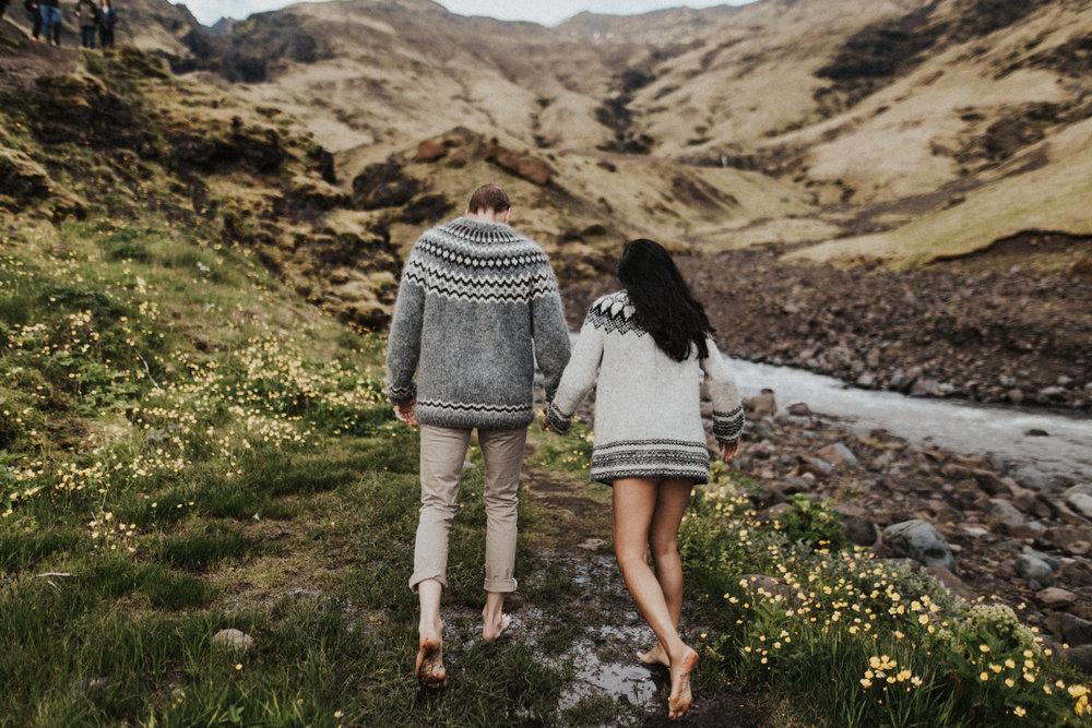 Barefoot couple walking around Iceland.jpg
