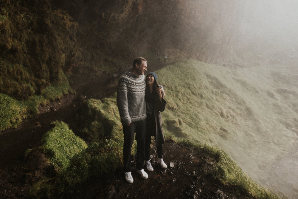 Happy couples session behind Icelandic waterfall.jpg