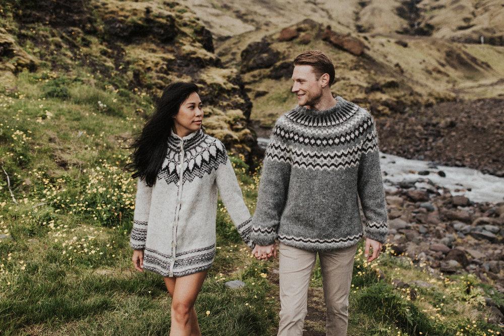 Barefoot couple walking in wilderness of Iceland in sweaters.jpg