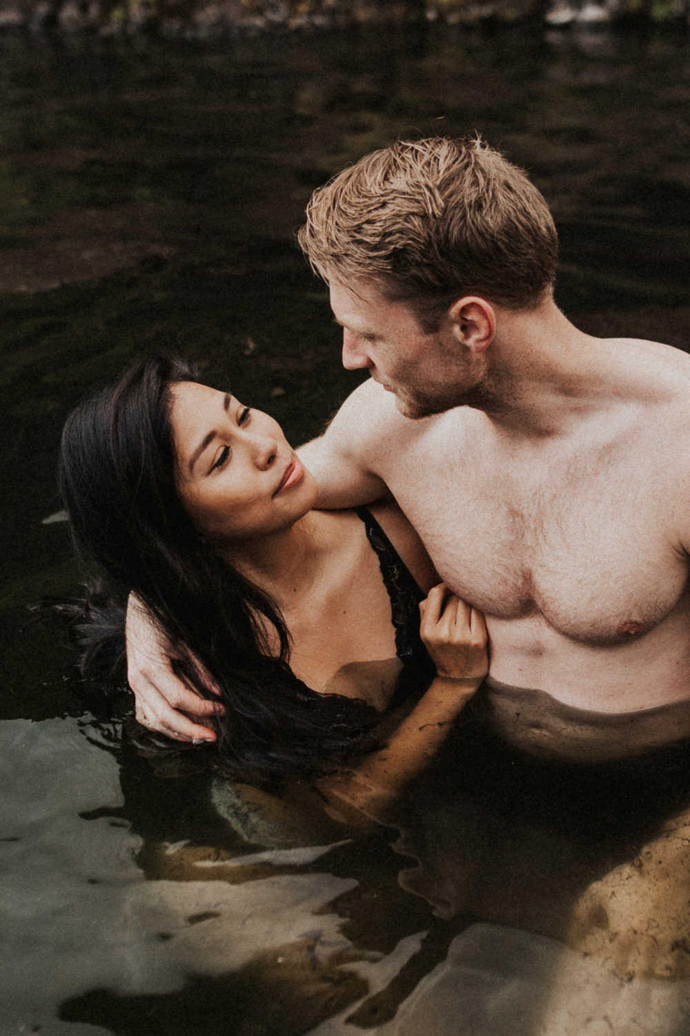 Beautiful mixed race couple in Seljavallalaug hot springs in Iceland.jpg