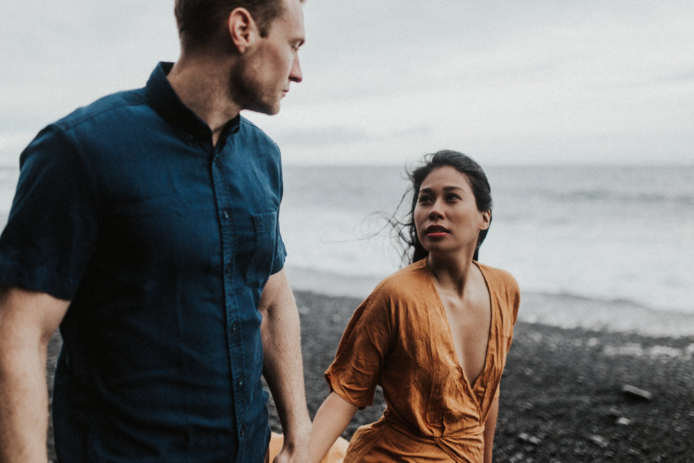 couple gazing at eachother in iceland on vik beack.jpg