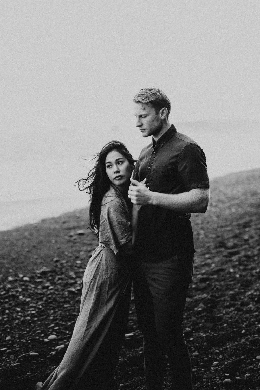 stunning couple on black rocks on vik beach iceland.jpg