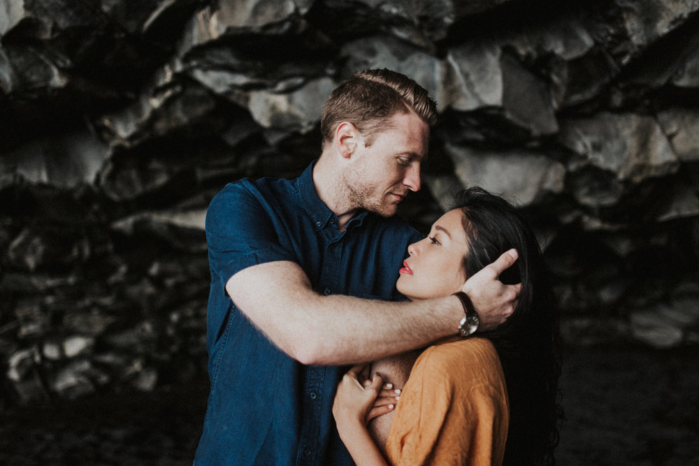 couple holding head in vik caves in iceland.jpg