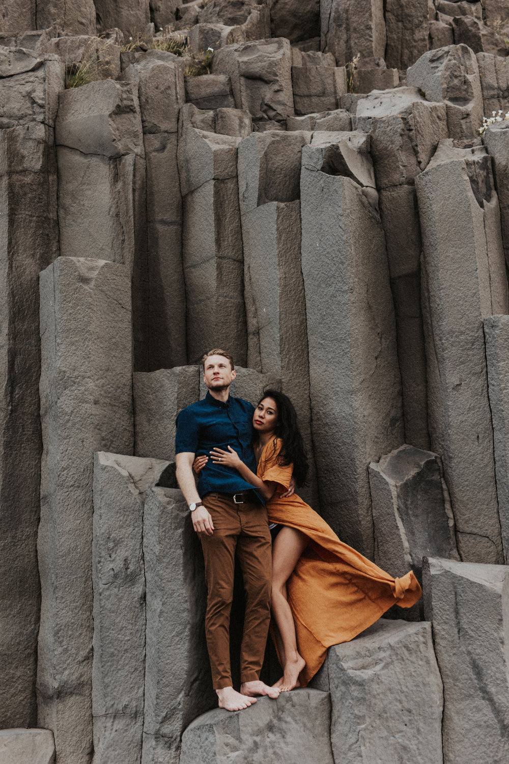 gorgeous couple at Vik with flowing orange dress in iceland.jpg