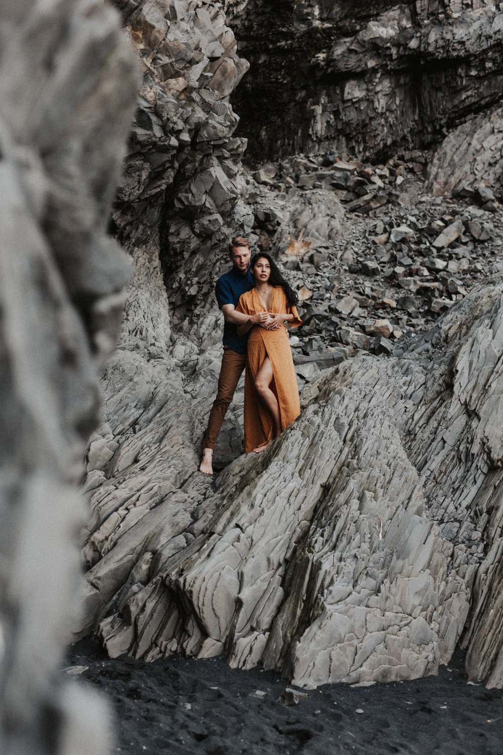 distance shot of gorgeous couple at vik beach in iceland.jpg