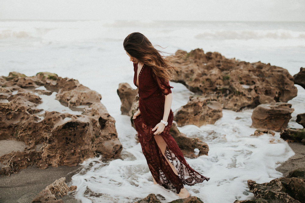 flowing red dress engagement session blowing rocks state park florida.jpg