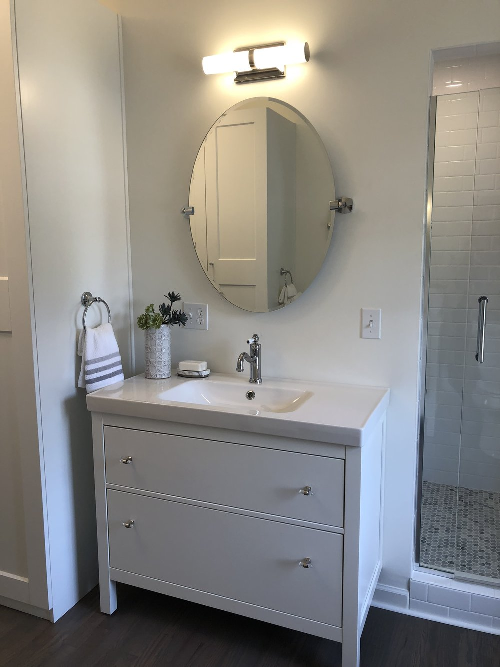 Instead of one long vanity, we installed twin vanities with lots of extra storage.