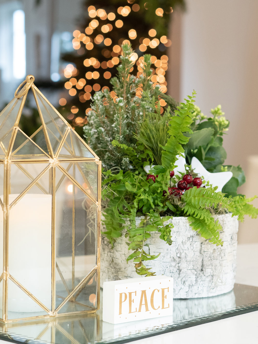 Lanterns, used year round, take on a new flavor with Christmas touches.
