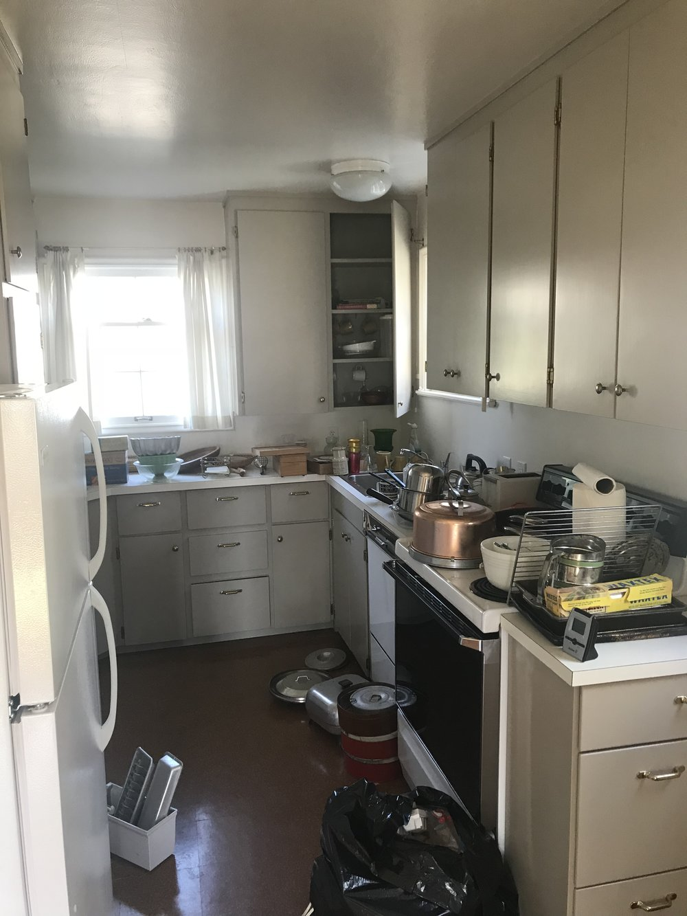 Copy of The outdated kitchen was small and dark with very little storage.