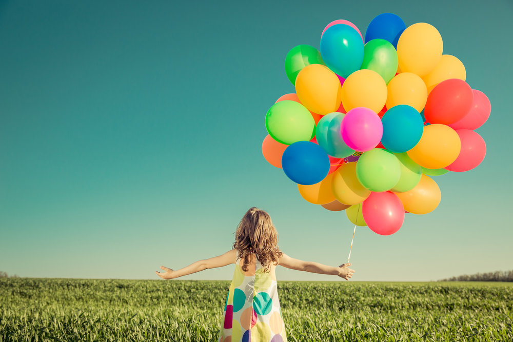 bigstock-Child-With-Toy-Balloons-In-Spr-177444847.jpg