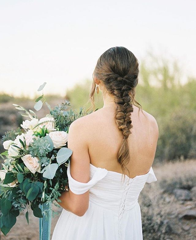 The back of this dress is RIDICULOUS! . We love our dresses on film 🙌🏻💜🔥 ... Photography: @megansorensonphoto . . . #dressrental #weddingdress #fineartbride #fineartrentals #bouquet #braid #coldshoulder #chiffon