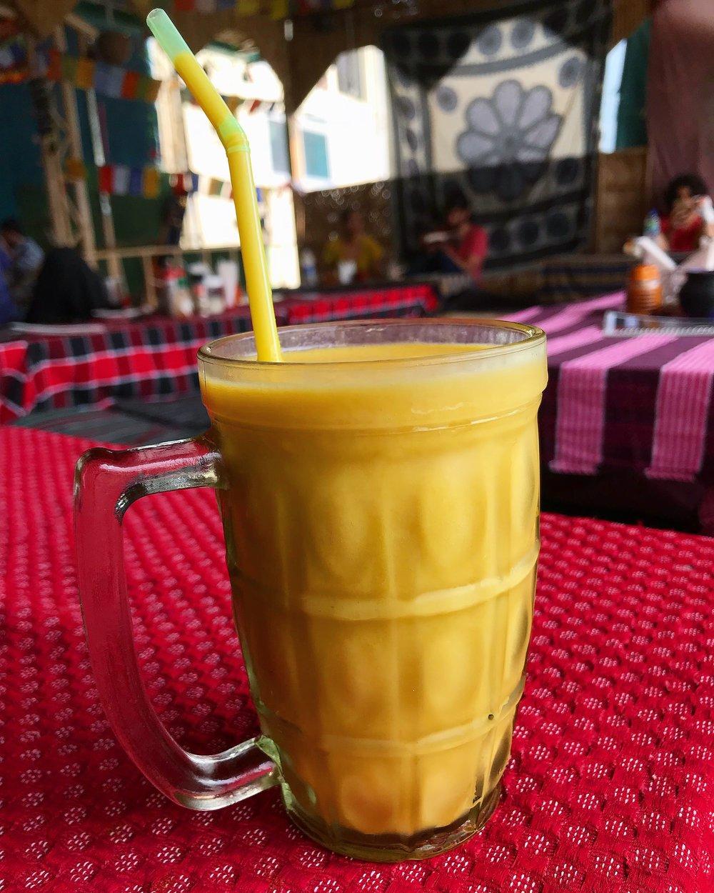A delicious homemade soy mango smoothie at Shambala Cafe, Rishikesh.