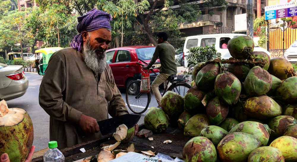 Fresh coconut water on the streets of Delhi.