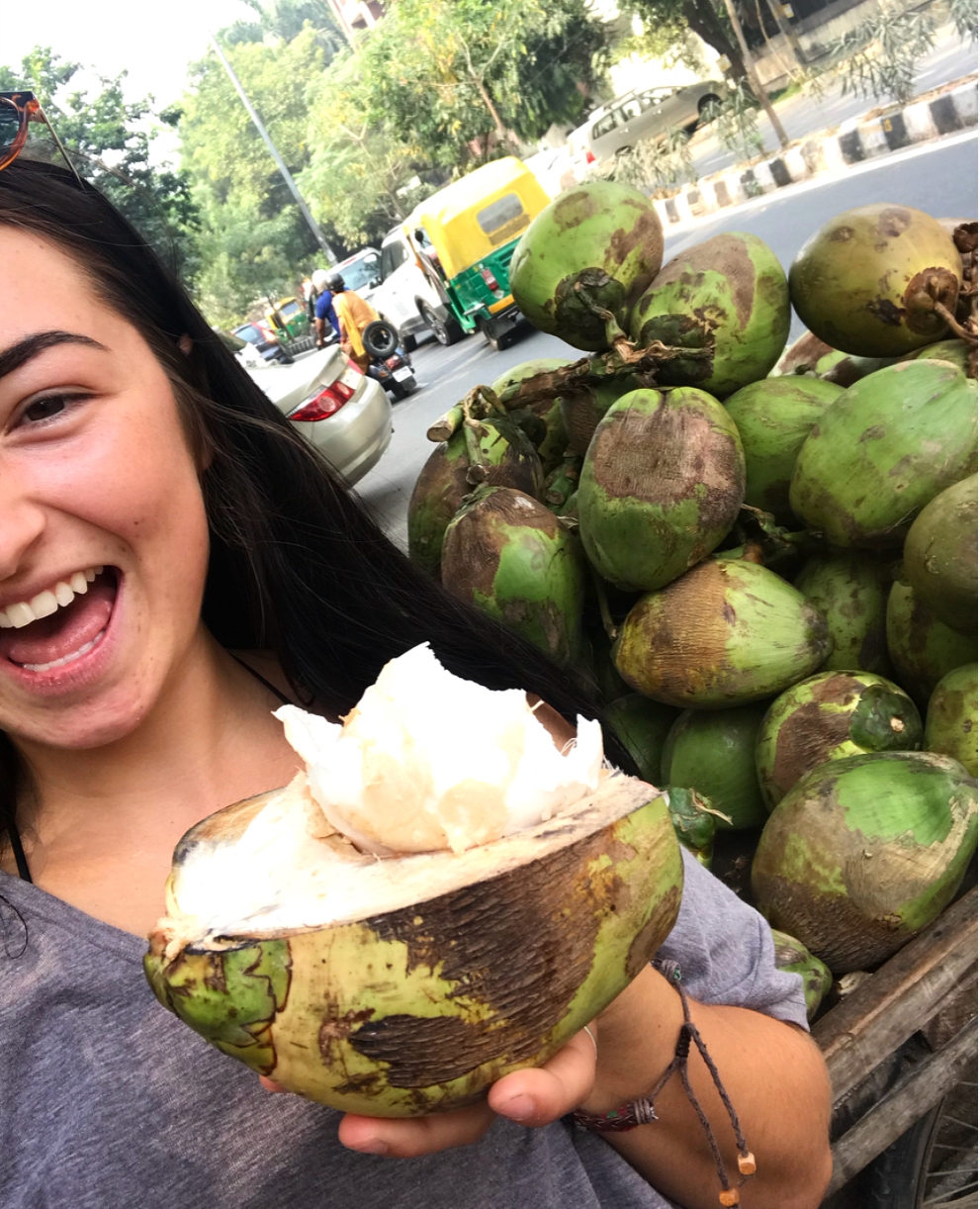 A bit excited that I got to eat the coconut flesh after I drank the water.
