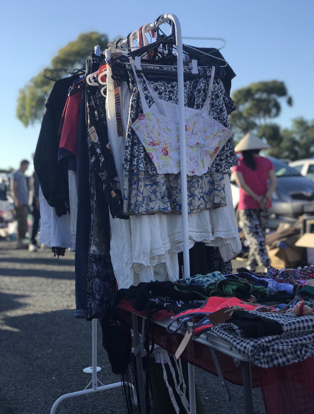 Selling a whole load of my clothes at the market.