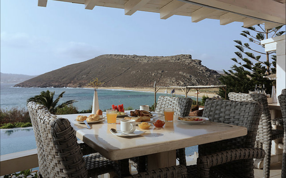 Daily breakfast with a stunning sea view.
