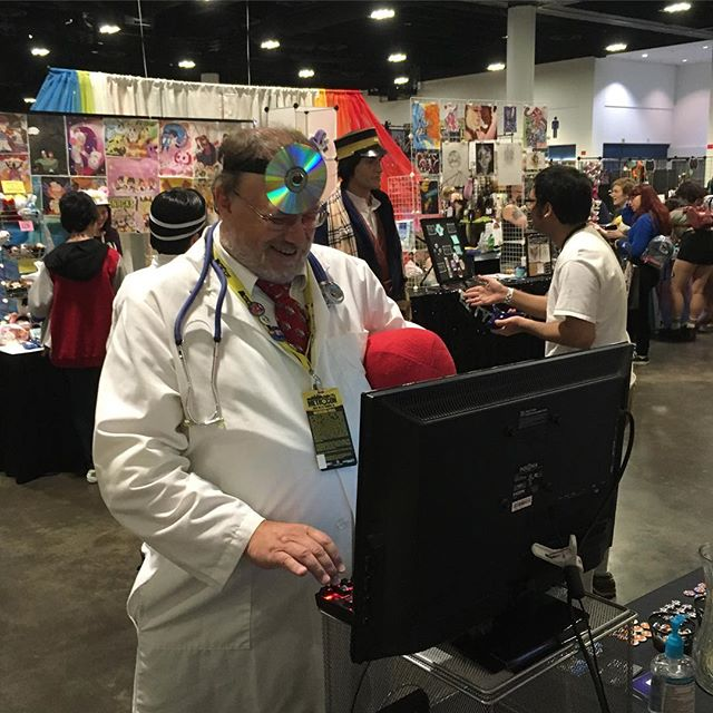 Surprise visit by another retro puzzle master: Dr. Mario! Was an honor to have him stop by and play our game. More pics / video coming later this week! #drmario #cosplay #metrocon
