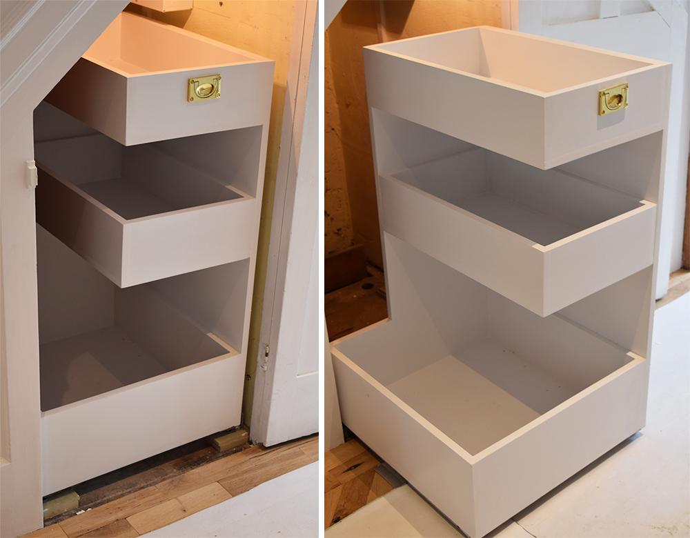 Under stair concealed storage solution.jpg