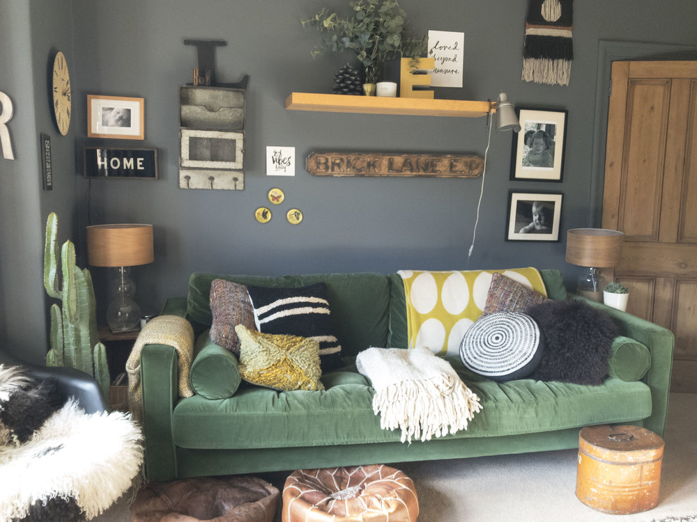 Picture 2 shows my green velvet sofa from  MADE , against a painted wall in downpipe by  Farrow and Ball . Sources:Cushions,  Grey September Stores ,  Covet Ilkley . Black circle cushion,  Yellow thrown;  Orla Keirly .  Faux plants  and  eucalyptus .Moroccan poufs, picked up at the souk in Morocco.Industrial light. Covet, as above.Wall hanging. Happy Mountain Designs. Etsy.All other items sources as thrift/ebay