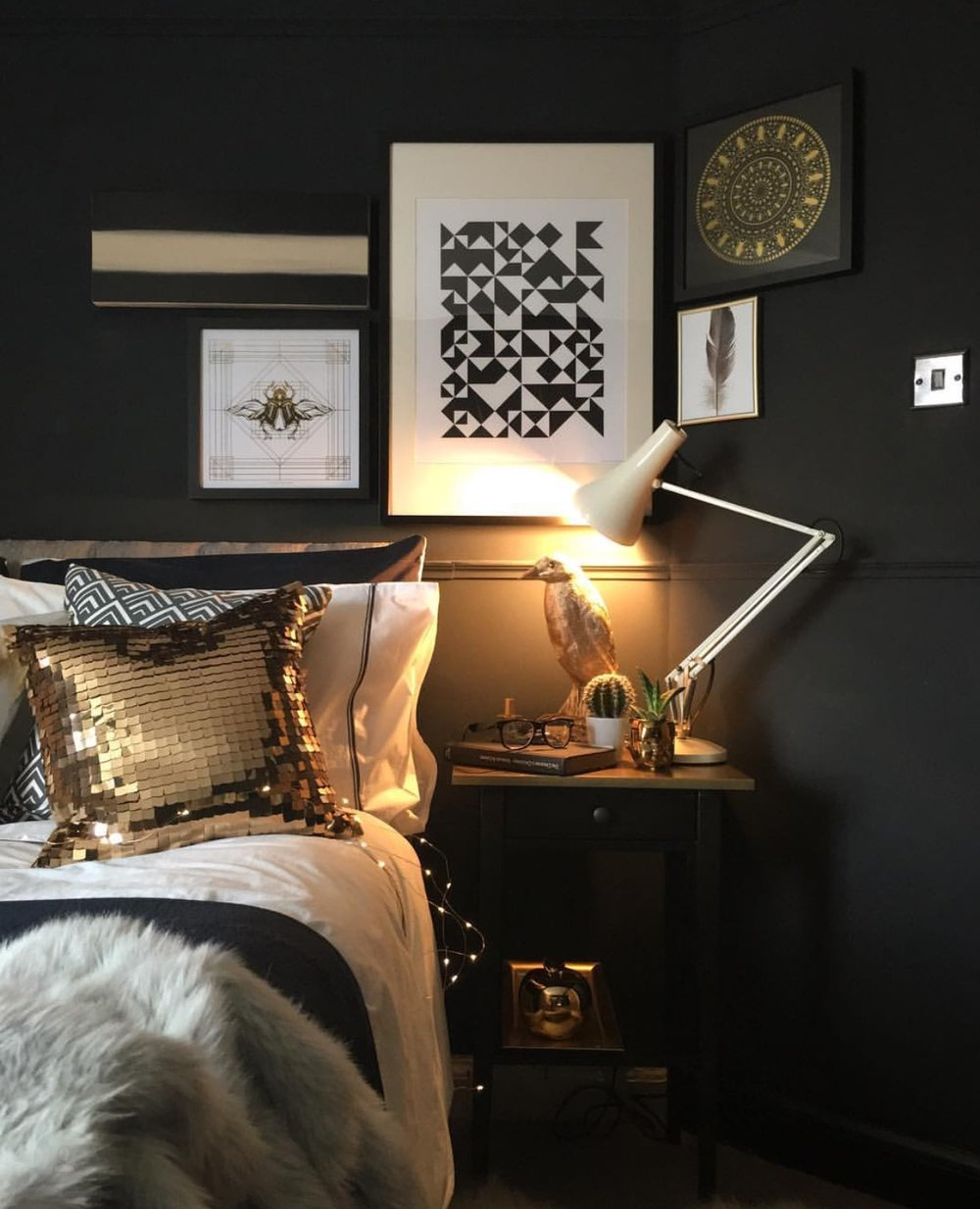 "In Nadia's bedroom, the dark and gold theme continues. ""The master bedroom has a balcony and views of the garden,"" Nadia explains."